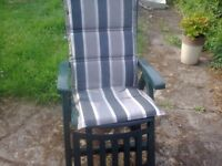 A green reclining garden chair with cover.
