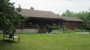 EXECUTIVE LOG HOME ON 6.9 ACRES IN KAWARTHA LAKES