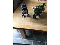 Kids toy dinosaur and toy motorbike