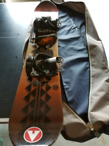 Snowboard with bag, bindings and goggles.
