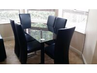 Olympic Glass Dinning Table and 6 Leather Chairs £100 ono