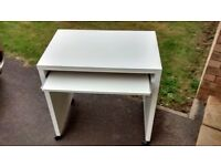Ikea Desk with pullout tray and shelf for storage on castors