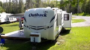35 foot 2012 Keystone Outback 298RE with 3 slides