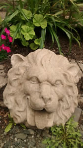 Cement lion face that is a fountain as well