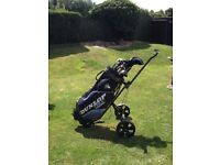 Set of Dunlop golf clubs and trolley