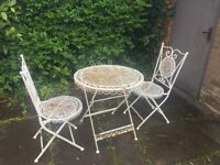 Antique wrought iron garden table and 2 chairs