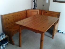dining table with corner storage bench seating.