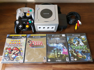 Nintendo GameCube with 2 controllers and 4 games.