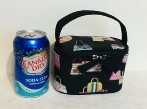 AVAILABLE. WHIMSICAL PRINT BLACK FABRIC PURSE