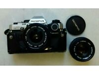 Olympus om 10 and two lenses.