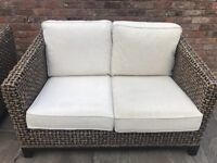 Two Rattan 2 seater sofas