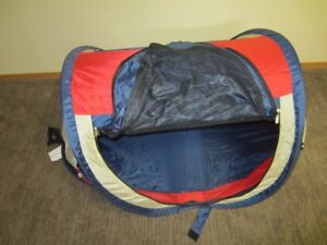 Pop up tent with sleeping bag.