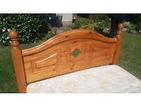 Double bed with wooden frame and dreamland mattress