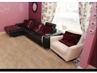 Large black, leather Corner Sofa brought 3 years ago for £1800 from Harveys. Good condition.