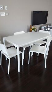 White dining room table with 4 chairs