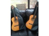 2 junior guitars with guitar cases