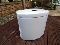 Brand new never used white close-coupled cistern