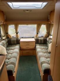 Abbey Aventura 2003 2 berth caravan with full Isabella awning
