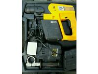 Jcb 24 volte hammer drill complete with 2battreys and charger in box