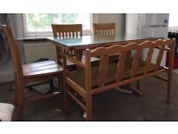 Pine dining table with removable glass top and 4 chairs and bench