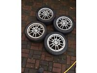 4 alloy wheel rims with tyres that are 15 inch.