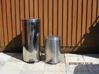 Two Chrome waste bins. One Large other standard size.