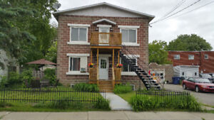 TRIPLEX FOR SALE IN CHOMEDY,LAVAL.REVENUE YEARLY $26000.00