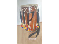 Full size dhol drum with playing sticks, decorations, strap & carry bag