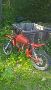 Two Xr 80 Frames With Parts Engine