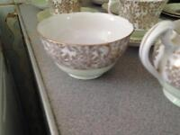 Gold rimmed tea set milk jug sugar bowl