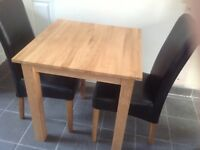 Solid Oak kitchen Table 75cm square, Plus Two matching leather faced Scroll Back chairs