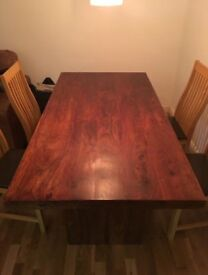 Solid dark wood dining table