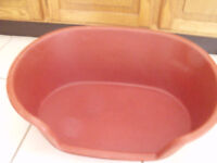 red plastic pet bed 14 x 21 inches approx