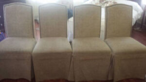 4 beige fabric chairs
