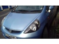 Honda Jazz five door with sunroof. No time wasters please.