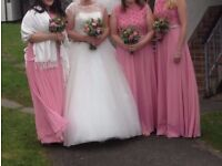 4 x Brand New Bridesmaid dresses in Rose Pink sizes 10,12,16 and 18. Still in original packaging