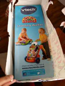 Brand new VTECH Sit to Stand Learning Walker.