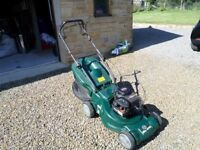 Petrol powered lawn mower, self propelled, Briggs and Stratton Sprint 40 four stroke engine.