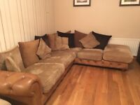 Large corner sofa/ pouffet. Washable cushions and covers. Part leather. Excellent condition. £350.