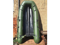 Inflatable boat with outboard and launching wheels package