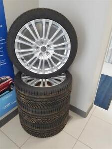 WINTER TIRES AND RIMS FROM A 2017 RS