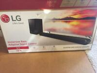 LG 100w sound bar with external subwoofer and remote New
