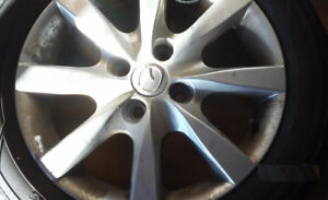 Three very good condition tires and rims