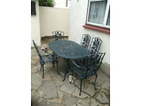 Cast aluminium garden table and 5 chairs