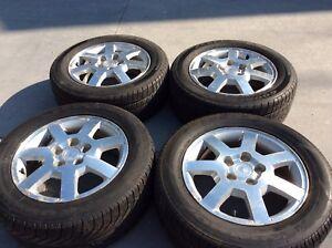 4 Tires on Cadillac Rims