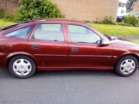 Red Vauxhall Vectra