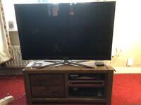 Wooden corner tv unit.