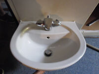 SMALL WHITE SINK WITH CHROME TAP