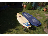"""Mark Phipps 6'2"""" surboard complete with leash and board bag."""