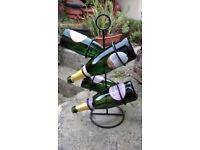 Wine Rack Holder, painted black metal, holds 4 bottles, H48cm W18cm (apx). Attractive design.